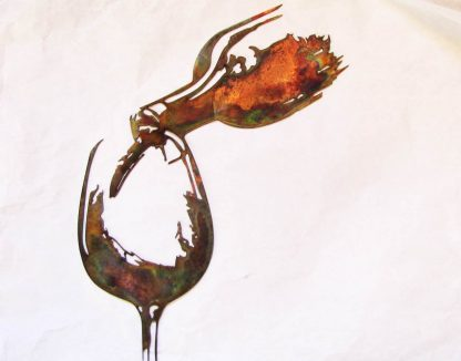 metal wine bottle pouring wall art